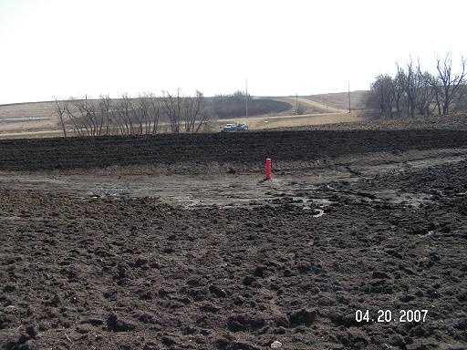 Photo of BMP sediment control basin with no growth.