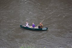 Photo of three young ladies canoeing down the river.