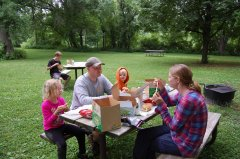 Photo of family eating lunch.