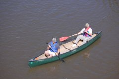 Photo of two men in a canoe.