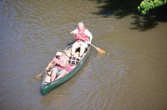 Photo of two women in a canoe.