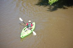 Photo of man in kayak.