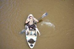 Photo of man in a kayak.