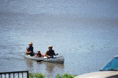 Photo of 3 people a canoe.